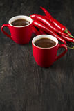 Hot chocolate with red chili peppers Royalty Free Stock Photo