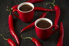 Hot chocolate with red chili peppers Stock Photography