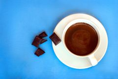 Hot chocolate with chocolate on side. Top view. Royalty Free Stock Photo