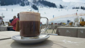 Hot chocolate on the ski slopes Stock Images