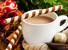 Hot Chocolate with Spiral Snack with Christmas Decoration Royalty Free Stock Photo