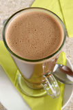 Hot chocolate. In a tall latte glass top down view Stock Images