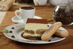 Hot chocolate and tiramisu. And grains of coffee Royalty Free Stock Images