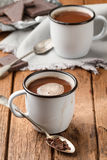 Hot chocolate in two enamel mugs Stock Images