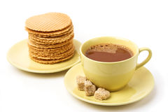 Hot chocolate and waffles. A cup of hot chocolate and sweet waffles Royalty Free Stock Photo