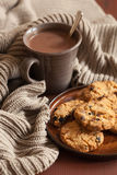 Hot chocolate warming drink wool throw cozy autumn cookies royalty free stock photo