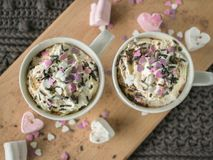 Hot chocolate with whipped cream and toppings royalty free stock image