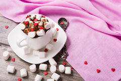 Hot chocolate in white cup with marshmallow and sweet hearts Royalty Free Stock Photo