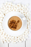 Hot chocolate in white Cup powdered cocoa with  many plump small Stock Photos