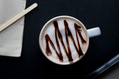 Hot chocolate in white mug on dark background, top view Royalty Free Stock Image