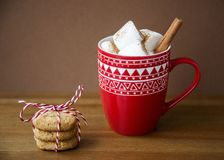 Hot Christmas Beverage Cocoa and Marshmallow with Oat Cinnamon Cookies. Hot Christmas Beverage Cocoa and Marshmallow in Red Pattern Cup with Stack of Oat Royalty Free Stock Photo