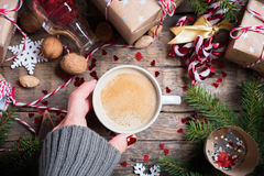 Hot Christmas Beverage in Cup Presents Background royalty free stock photography