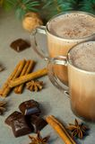 Hot Christmas Drink Cocoa Coffee or Chocolate with Milk in a Small Cup. Fir Tree Branch, Nuts, Cinnamon Sticks Star Anise Royalty Free Stock Image