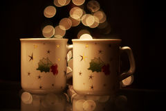 Hot christmas drinks. Christmas cups with bokeh background Stock Photography