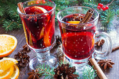 Hot christmas mulled wine with snow, cinnamon sticks, anise and orange Royalty Free Stock Photography