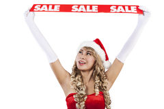 Hot Christmas sale banner by Mrs Claus in white. Mrs. Claus is holding Christmas sale banner in the air by raising her hands isolated in white Royalty Free Stock Photos