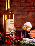Hot cider cocktail with cookie and bottle of white wine. Still life of warming cider cocktail with bottle of white wine . Label on bottle of wine. Warming punch Stock Images