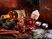 Hot cider cocktail with ginger snap and white wine bottle . Royalty Free Stock Photography