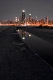Hot City. Chicago night skyline with partial beach and water reflections Royalty Free Stock Photo