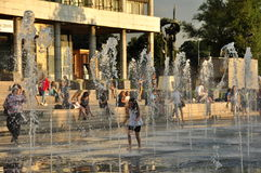 Hot city. The girl runs across the fountains in Museon park, near the Gorky Central Park of Culture and Leisure in Moscow, June 2016 Royalty Free Stock Photography