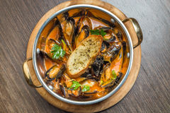 Hot clam chowder and vegetables, cooked in a pot Stock Photo