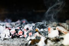 Hot coal, embers of the grill and smoke close up.  royalty free stock photography