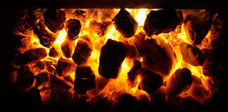Hot coal in the flames. As nice background stock photography