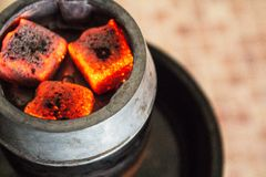 Hot coal for hookah. The hot coal in kaloud for hookah royalty free stock photography