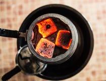 Hot coal for hookah. The hot coal in kaloud for hookah Stock Photos