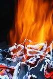 Hot coals. With yellow flames Royalty Free Stock Photo