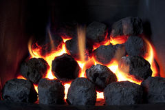 Hot coals. Gas fire burning with artificial coals Stock Photo