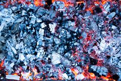 Hot coals with ash in the grill Stock Photos