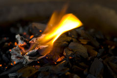 Hot coals with flame. Flame over glowing, hot coals Royalty Free Stock Photo