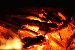 Campfire with hot coals. Hot coals and flames in burning campfire Stock Images