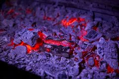 Hot coals in the grill closeup in the restaurant Royalty Free Stock Photography