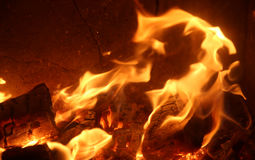 Hot coals. Red-hot coals with blue flame in an oven Stock Image