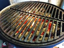 Hot Coals in a Weber Smoky Joe. With cast iron grill-grates ready to grill Royalty Free Stock Photos