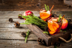 Hot cocktail with apple, rosemary, cinnamon. Christmas, Thanksgiving drinks. Autumn, winter cocktail grog, hot sangria, mulled wine - apple, rosemary, cinnamon stock photography