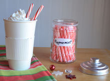 Hot coco Mocca with peppermint sticks inside and jar Royalty Free Stock Images
