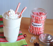 Hot coco with peppermint sticks jar and snow flakes Stock Photo