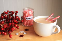 Hot coco with peppermint sticks jar wreath and snow flakes Royalty Free Stock Images