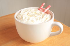 Hot coco with peppermint sticks and whipped cream Royalty Free Stock Image