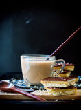 Hot Cocoa with Chocolate Cookies on Black Background Royalty Free Stock Image