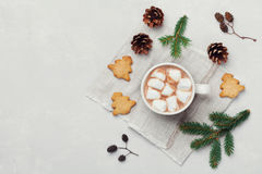 Hot cocoa or chocolate with marshmallow and cookies on white table from above. Traditional winter drink. Flat lay. Stock Images