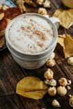 Hot cocoa coffee with popcorn, apple, cakes, leaves on the old Royalty Free Stock Photography