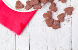 Hot cocoa and cookies hearts. Selective focus. Hot cocoa and cookies hearts Royalty Free Stock Photo