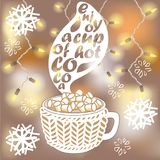 Hot cocoa cup with marshmallows on blurred background. Hot cocoa cup witn marshmallows and knitted cover on blurred background. Christmas lights garland and Royalty Free Stock Photography