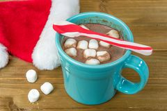 Hot cocoa drink with marshmallows and Christmas Santa cap Royalty Free Stock Photography