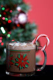 Hot Cocoa and Holiday Tree. Mug of hot cocoa with marshmellows in front of christmas tree Stock Image