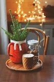 Hot cocoa with marshmallow, fir branches and Christmas decorations on wooden table in country house. Cozy homely scene, danish hygge concept Stock Image